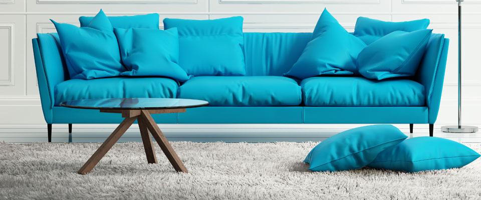 Blue sofa on fluffy rug